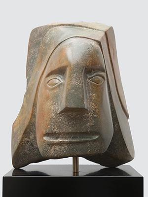Sculptuur beeld in bruine albast titel Oergevoel Ad van den Boom